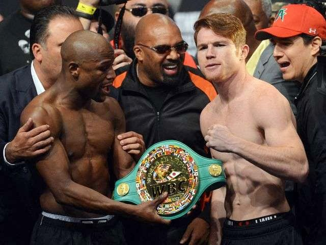 Photo of Alvarez makes weight, refuses belt from Mayweather