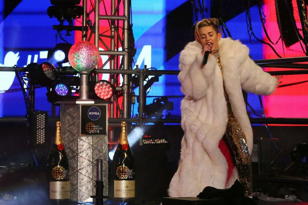 """Photo of Miley Cyrus dresses in """"the most clothes"""" she's been in all year for New Year's Rockin' Eve performance"""