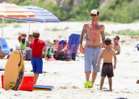 Photo of David Beckham Pecs the Beach for Family Day