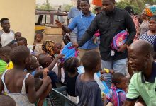 Photo of Photos: John Dumelo Donates Exercise Books, School Bags And Other Items To Kids At Roman Ridge In Accra