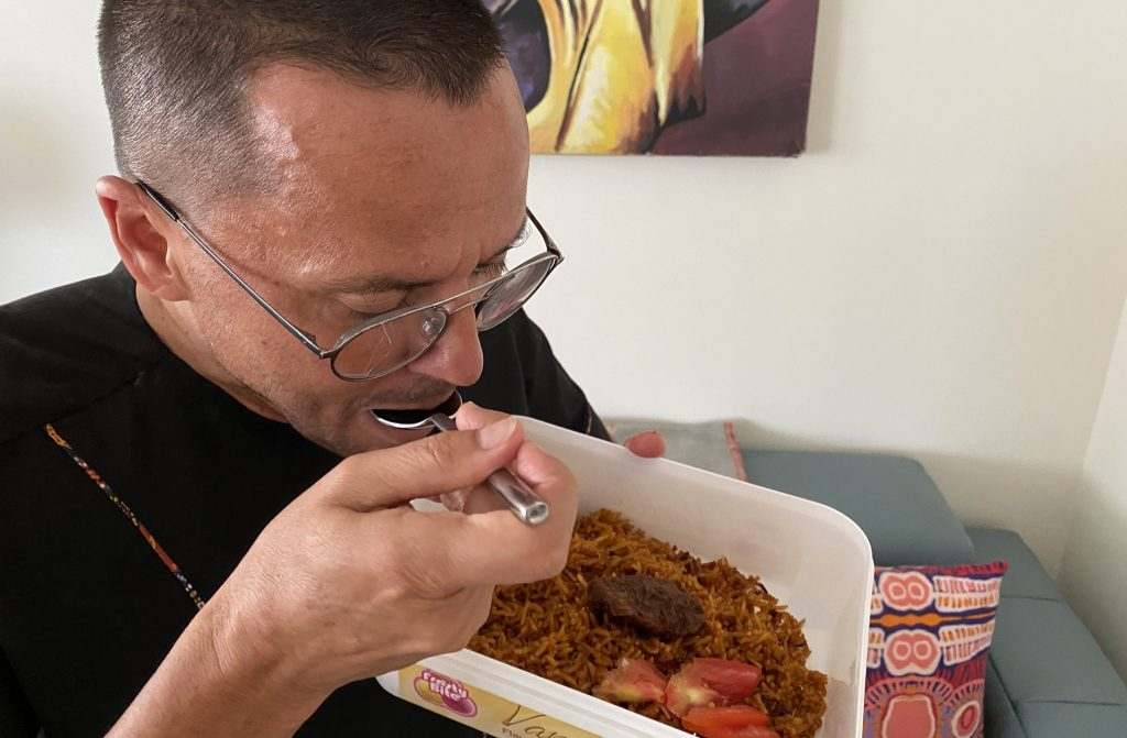 H.E Gregory Andrews Eating Ghana Jollof Rice